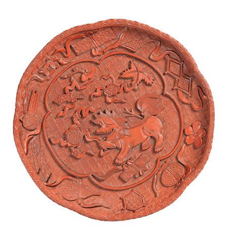 A rare red lacquer five-lobed 'Buddhist lion' dish Mid 16th century