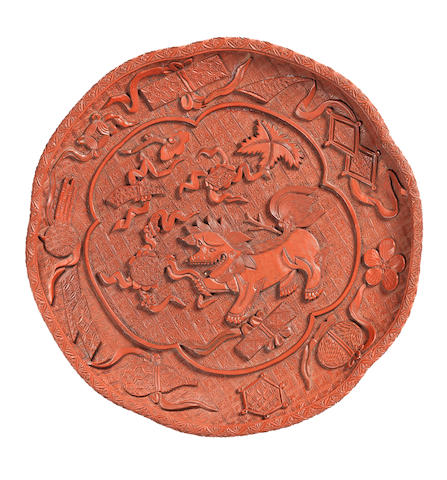 A rare red lacquer five-lobed 'Buddhist lion' dish Mid 16th century
