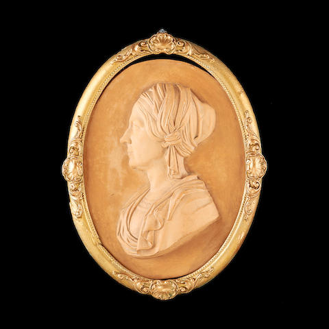 William Theed, British (1804-1891) A terracotta relief depicting a woman in profile date 1843