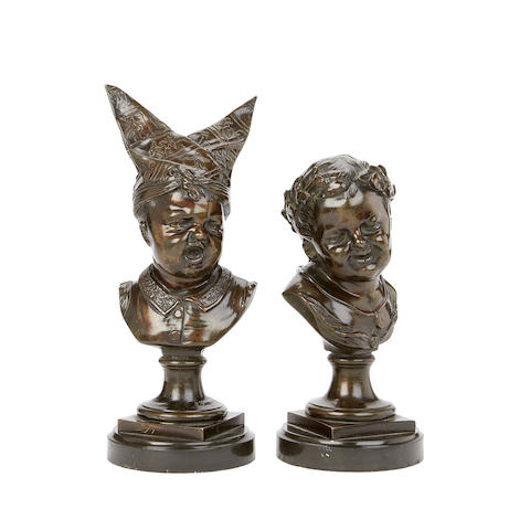 A pair of 19th century Dutch bronze busts of a crying boy and laughing boy