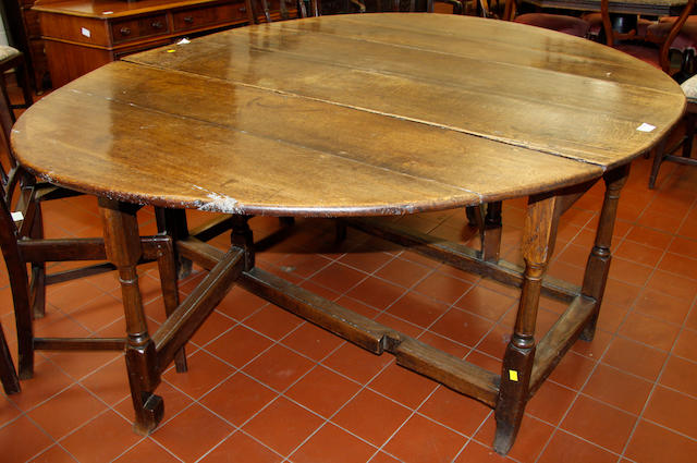 A late 17th Century country oak gate-leg table