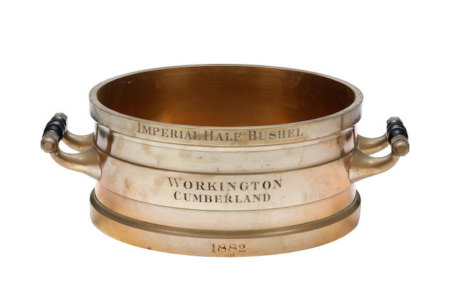 A late Victorian brass alloy Imperial Half Bushel measure, for the town of Workington in Cumberland, dated 1882by De Grave & Co., London (unmarked but ensuite with marked previous lot and marked Imperial Yard)