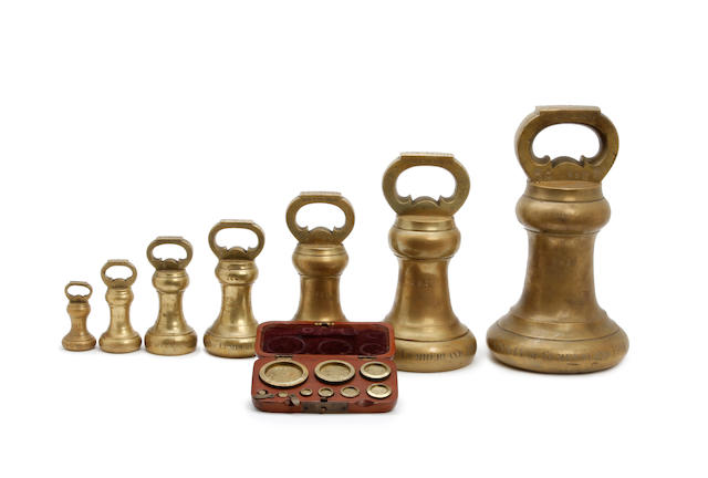 A boxed set of sixteen Edwardian brass alloy Imperial Avoirdupois weights, for the County of Cumberland, dated 1901by Doyle & Son, London