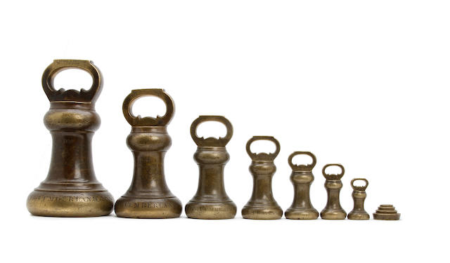 A set of eleven early Victorian brass alloy Imperial Avoirdupois weights, for the County of Cumberland, dated 1857by Nichol & Fowler, London