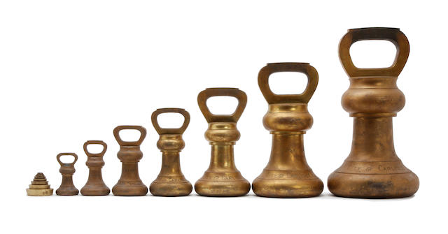 A set of fifteen brass alloy Imperial Avoirdupois weights, for the City of CarlisleProbably Edwardian (the earlist verification mark 1904)