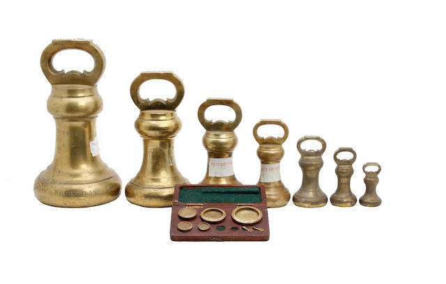 A boxed set of twelve Edwardian brass alloy Imperial Avoirdupois weights, for the County of Westmorland, dated 1901by Doyle & Son, London