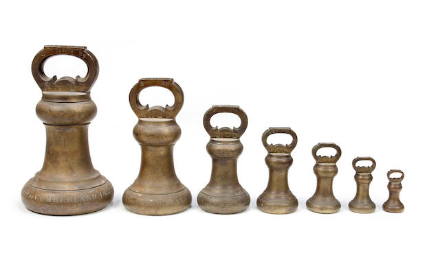 A set of seven early Victorian brass alloy Imperial Avoirdupois bell weights, of the Country of Cumberland, dated 1857by Nichol & Fowler, London