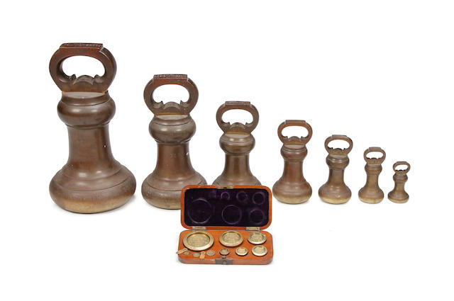 A set of sixteen late Victorian brass alloy Imperial weights, for Cumberland & Westmorland, dated 1893by Doyle & Son, London