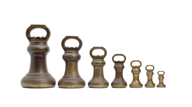 Seven mid-Victorian brass alloy Imperial Avoirdupois bell weights, for the County of Cumberland, six dated 1857by Nichol & Fowler, London