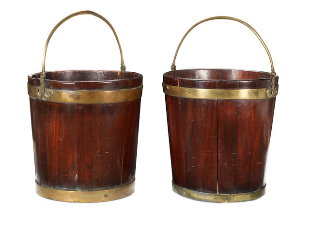 A matched pair of George III mahogany peat buckets