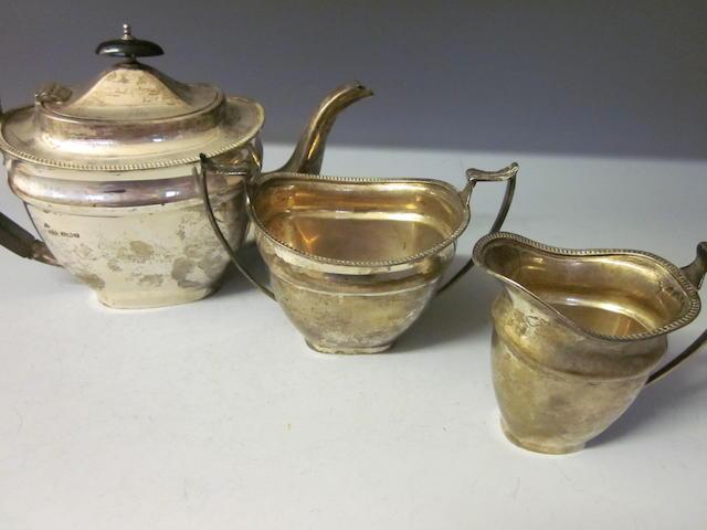 A three piece silver tea service, by E Viner,  Sheffield 1934,   (3)