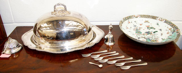 A mixed lot,comprising a clockwork silver table bell (marks rubbed), seven silver cake forks, an E.P table bell, E.P dish and cover, a Chinese famille verte dish (damaged) and twelve Vols. various, with leather bindings )parcel).