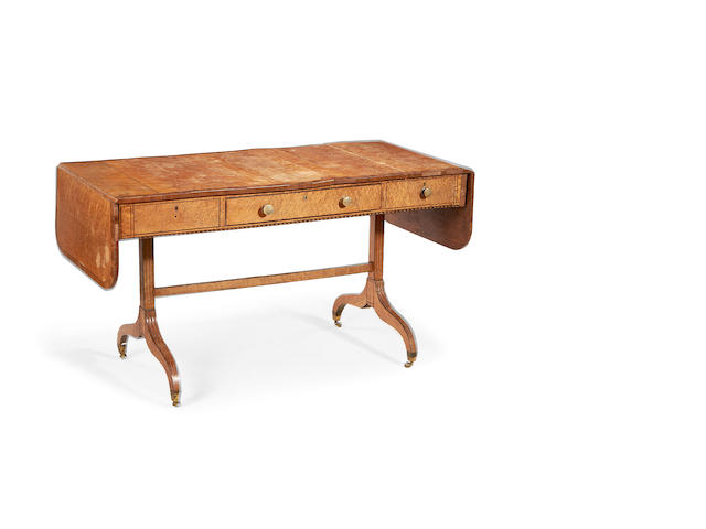 A Regency birds eye maple sofa table