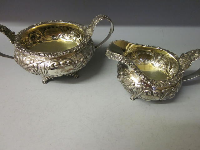 A George IV sugar bowl and cream jug,  maker W. H. London 1823,  (2)
