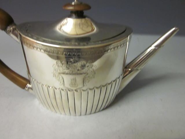 A George III oval silver teapot, by Henry Chawner, London 1793,