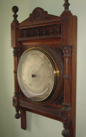 A late 19th Century oak framed aneriod barometer