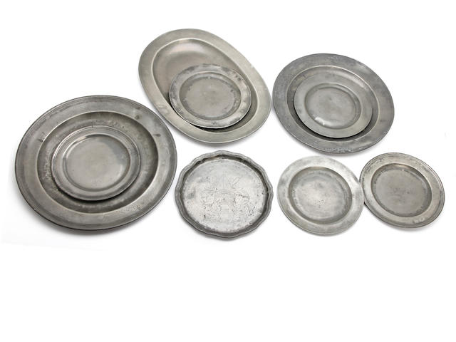 A miscallaneous collection of pewter plates, mostly 18th century