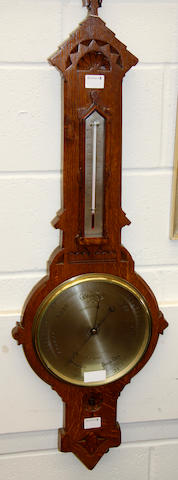 A late 19th Century oak cased aneroid barometer Negretti & Zambra