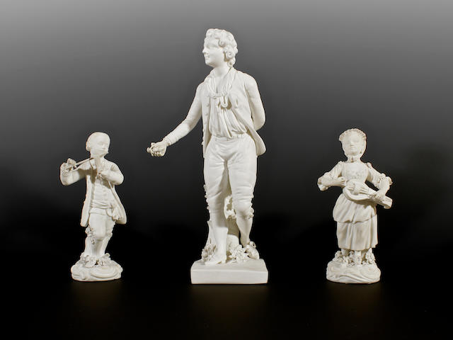 A Derby biscuit figure of a boy and a pair of small Derby biscuit musicians, circa 1785