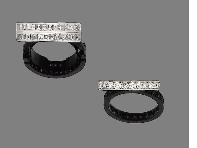 A pair of diamond earclips and two diamond rings (3)
