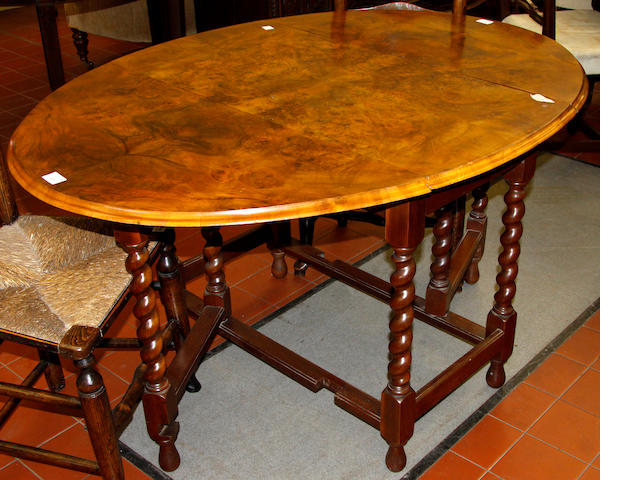 A walnut oval gateleg table 20th Century
