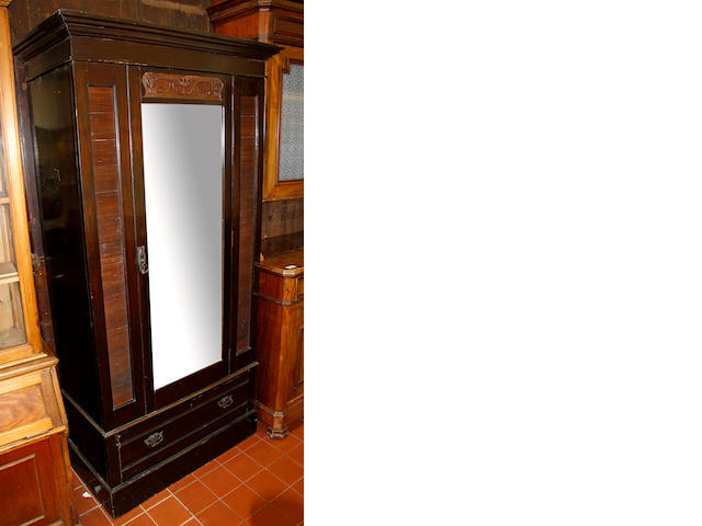 An Edwardian mahogany single, mirrored, wardrobe