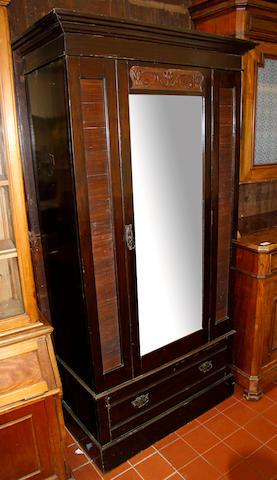 An Edwardian mahogany single, mirrored, wardrobe