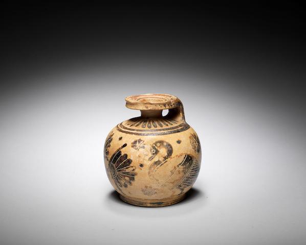A Corinthian pottery aryballos
