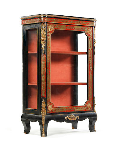A late 19th century ebonised, gilt metal-mounted and scarlet boulle pier cabinet