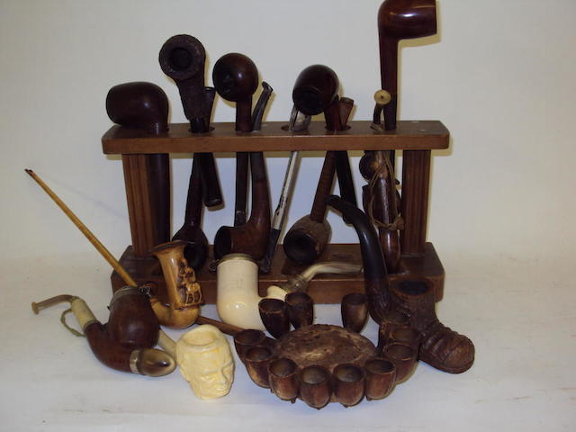 A very large collection of pipes and pipe smoking ephemera