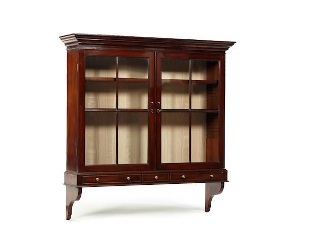 A mahogany and glazed mural display cabinet