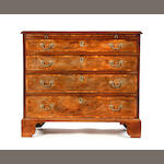 A George III mahogany, inlaid and crossbanded chest of drawers with brushing slide