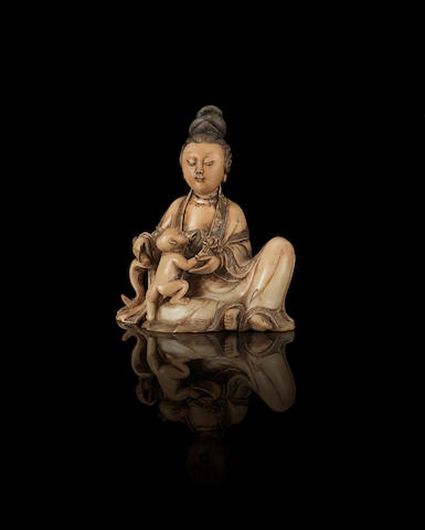 A soapstone figure of Guanyin and child 17th/18th century