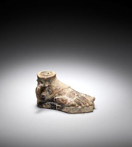 A Roman oil lamp in the shape of a foot