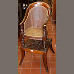 An early 19th Century childs mahogany high chair,