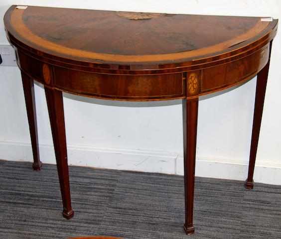 A George III mahogany and inlaid demi-lune tea table,