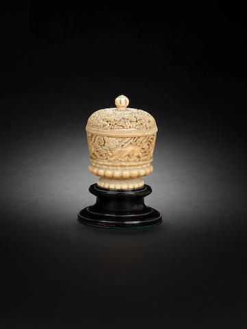 A carved ivory box and cover 17th century