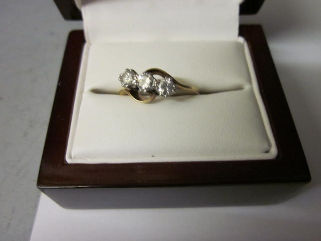 A three stone diamond cross-over ring,