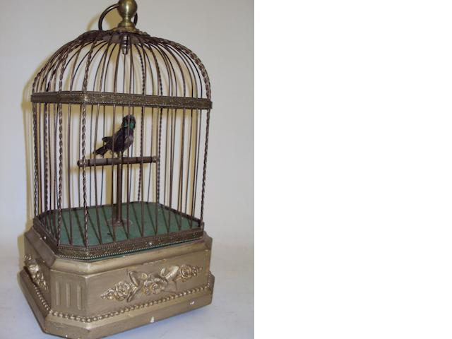 An automaton singing bird in cage