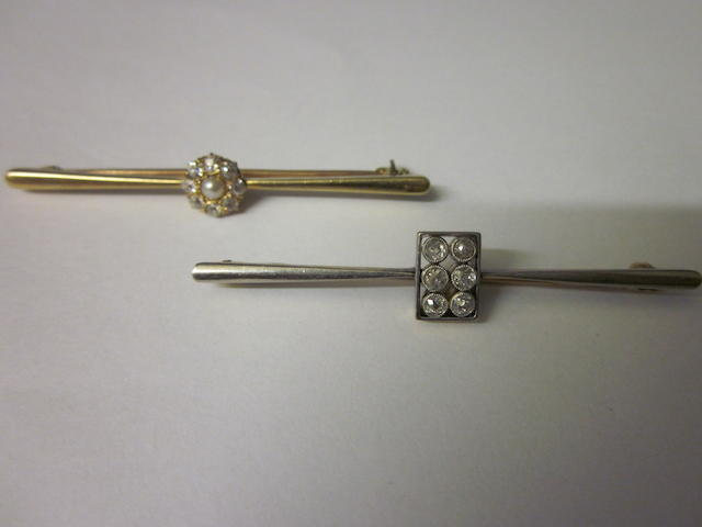 An Edwardian diamond bar brooch,  (2)