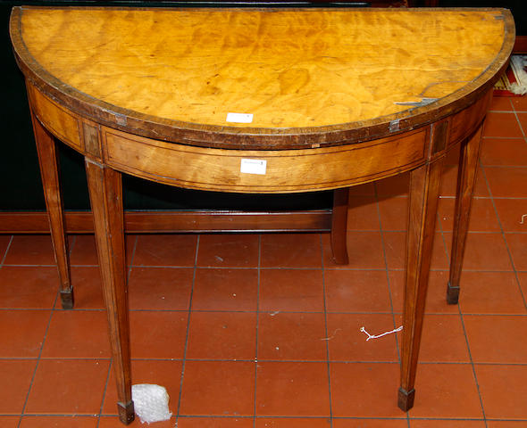 A George III satinwood demi-lune card table