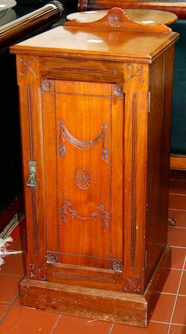An Edwardian mahogany bedside cabinet