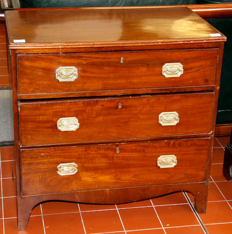 A George III mahogany bachelor's chest of three drawers