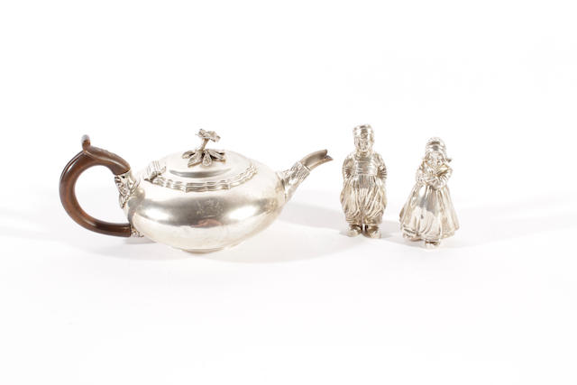 A pair of early 20th century Hanau silver condiments in the form of a Dutch boy and girl by Berthold Muller, with import marks for Chester 1907,  (3)