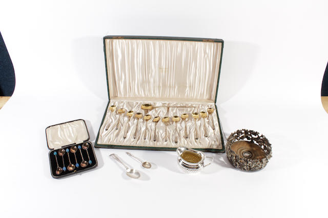 A set of twelve early 20th century American silver parcel-gilt ice cream spoons and matching serving spoon by Marcus and Co, New York stamped 'Sterling'  (6)