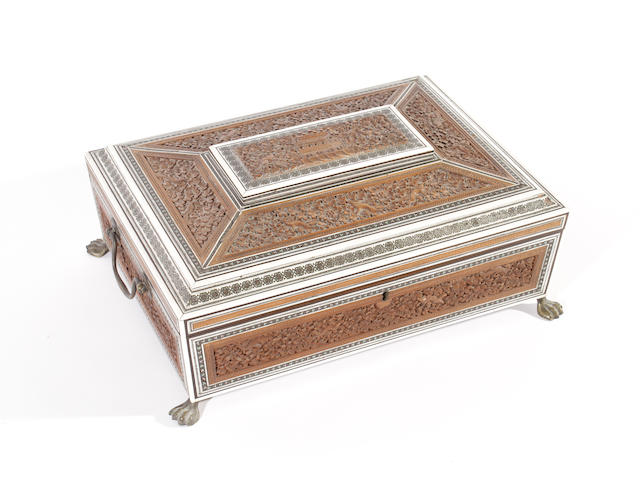 A mid 19th century Anglo-Indian sadeli work, sandalwood, ivory and ebony sewing box
