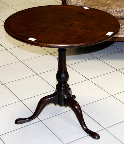 A George III mahogany circular tip-up tripod occasional table