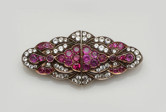 A ruby and white sapphire brooch