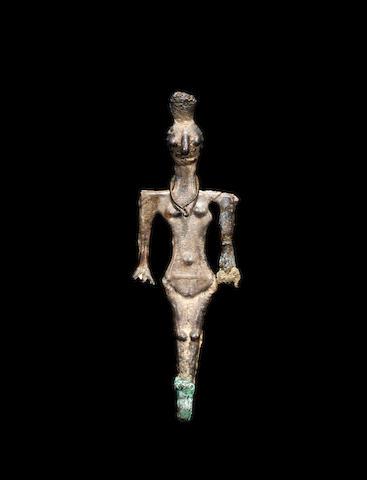 A Syro-Hittite silver fertility goddess