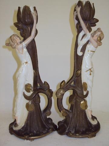 A pair of Austrian porcelain candlesticks